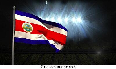 Costa Rica national flag waving on flagpole on black...