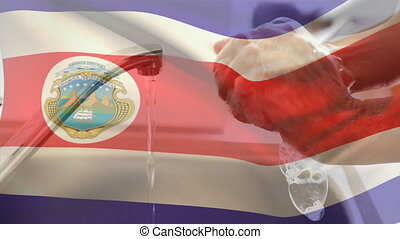 Costa Rican flag waving against mid section of woman washing hands in the sink