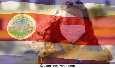 Costa Rican flag waving against woman wearing face mask