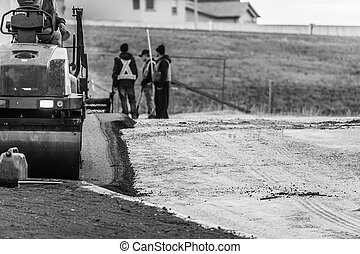 Costruction workers laying new Tarmac For New Parking Lot