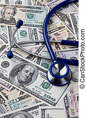 Costs of health, stethoscope and dollar bills