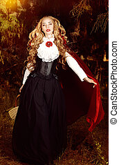 costume - Beautiful blonde woman in old-fashioned dress and ...