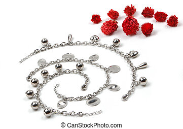 costume jewerly and red flowers