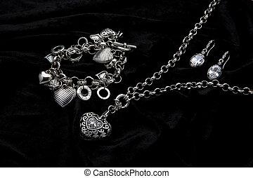 Costume Juwelery - Silver designer costume jewelery on black...
