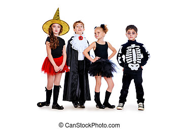 costumes - Group of cute children wearing halloween costumes...