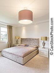 Cosy bedroom with golden amenities