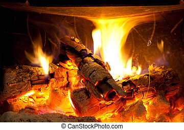 Cosy fireplace - Burning logs in a cosy living room chimeney