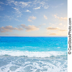 stone beach and turquiose water splash of cote dAzur at summer morning, France