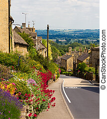 Cotswolds village Bourton-on-the-Hill with flowers, UK