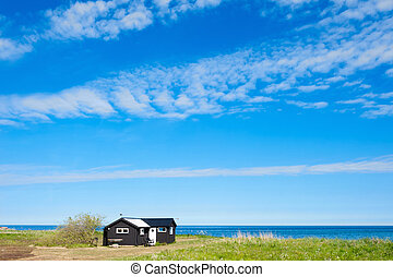 Cottage at the beach of the island