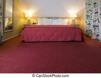 Cottage bed - A luxury double bed in a warm, cosy room