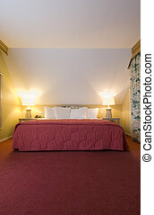 Cottage Bed - A luxury double bed in a warm cosy bedroom