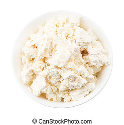 Cottage cheese in white bowl isolated on a white background, top view.