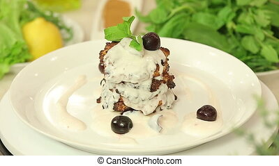 Cottage cheese pancakes with cherry yogurt topping