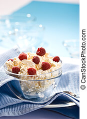 cottage cheese r - Glass bowl with soft cheese and raspberry