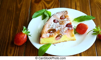 cottage cheese sweet casserole with strawberries on a wooden...