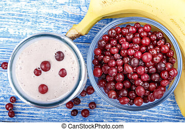 cottage cheese with cranberries and banana on the table