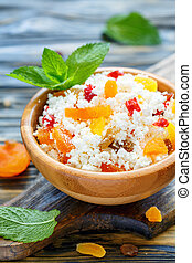 Cottage cheese with dried apricots and raisins.