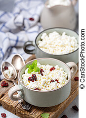 Cottage cheese with dried cranberries in a bowl.