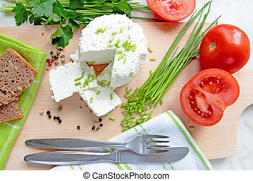 Cottage cheese with fresh herbs and vegetable