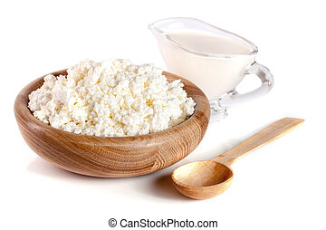Cottage cheese with sour cream in a wooden bowl isolated on a white background