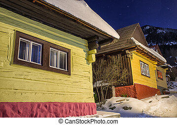 Cottage in UNESCO village Vlkolinec at winter night, Slovakia