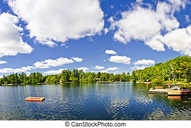 Cottage lake with diving platform and dock