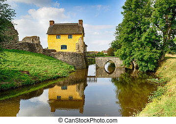 Cottage on a Moat - A pretty thatched cottage built into the...