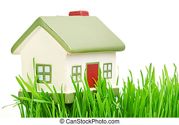 Cottage. New little cottage and green juicy grass.