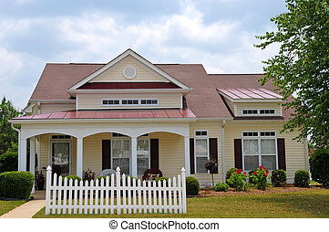 Cottage Style House with White Picket Fence
