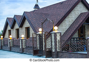 cottage surrounded by a forged fence. - Modern cottage...
