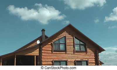 Cottage. - Time lapse shot of log house against the sky and...