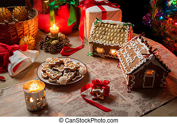 Cottages and gingerbread cookies on the Christmas table