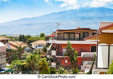 cottages in Giardini Naxos town and view of Etna - travel to...