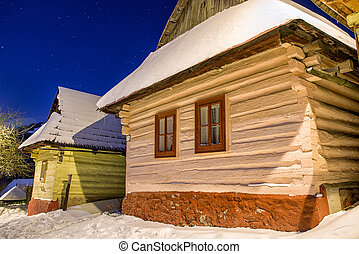 Cottages in UNESCO village Vlkolinec at winter night, Slovakia