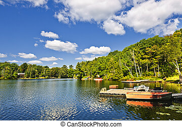 Cottages on lake with docks - Beautiful lake with docks in ...