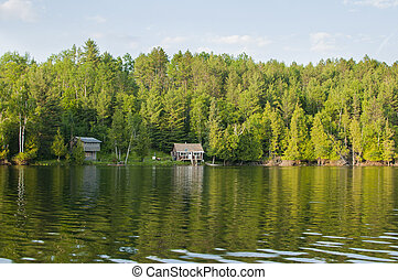 Cottages on Ontario lake - Lonely wooden cottages on a...