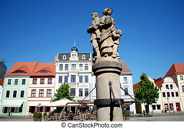 cottbus, germany, altmarkt market place with well and historic houses