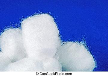 Cotton balls in blue background