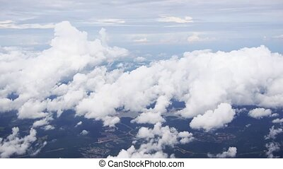 Cotton Clouds Below from Airline Passenger Perspective -...