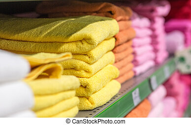 cotton colored towels on the shelves market