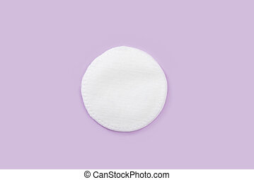 Cotton disk on a pink background, spa, close-up