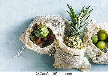 Cotton fabric bags with Green Fruits on blue background.