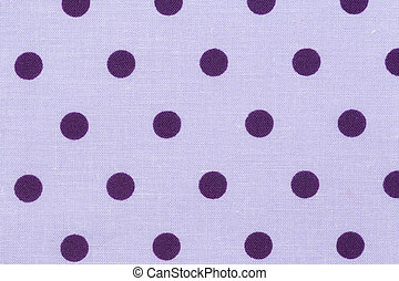 Cotton fabric with purple dots, abstract background.