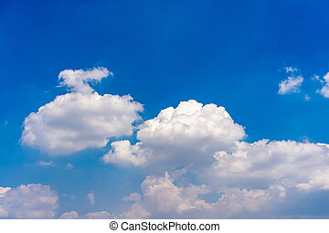 Cotton like white clouds on blue sky background