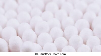 Cotton sticks in bulk - On the blue surface of a cotton swab...