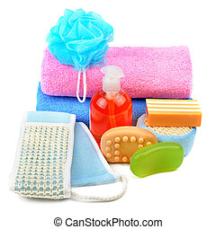 Cotton towels, cosmetic soap and shampoo isolated on white background.