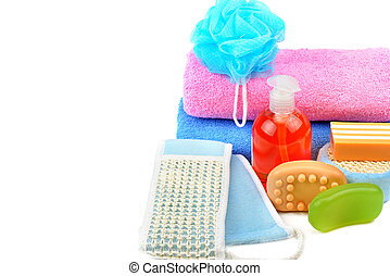 Cotton towels, cosmetic soap and shampoo isolated on white background. Free space for text.