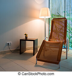 couch lounger with small table and lamp on tile floor