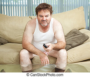 Couch Potato Watching TV - Unemployed man sitting home...